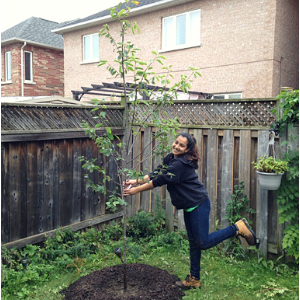LEAF staff posing happily next to a newly planted serviceberry