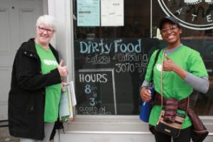 Volunteers posing beside store front