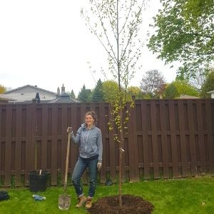 Adriana Rezai-Stevens, LEAF Planting and Stewardship Coordinator, after planting a paper birch