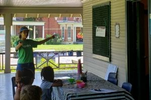 Junior urban forest ranger speaking to children