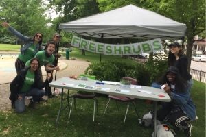 LEAF staff and volunteers posing by the free native shrub giveaway table