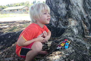 © 2017 Creative Commons Boy plays by tree