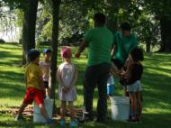 kids standing around a tree