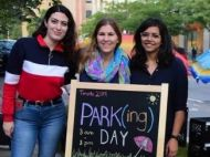 "Young women by sign, ""Park(ing) Day"""
