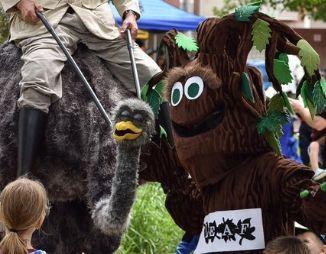 Barkley next to a puppet ostrich