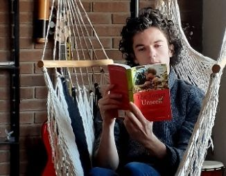 Brian Millward reading a book