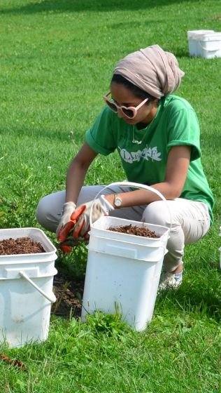 Young Urban Forest Leader mulching a tree