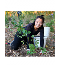 LEAF volunteer planting a shrub