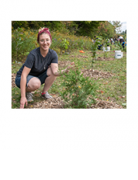 King resident planting a tree at a community tree planting event