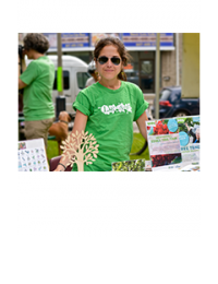 LEAF Volunteer at an outreach table