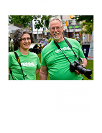 Two LEAF volunteer photographers smiling with their cameras