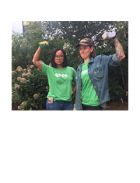 Two LEAF volunteers posing with flexed arms, feeling happy after working on the Learning Gardens