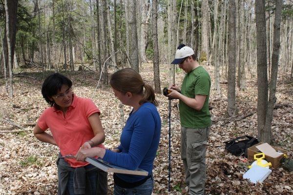 Danijela in the field talking with community members